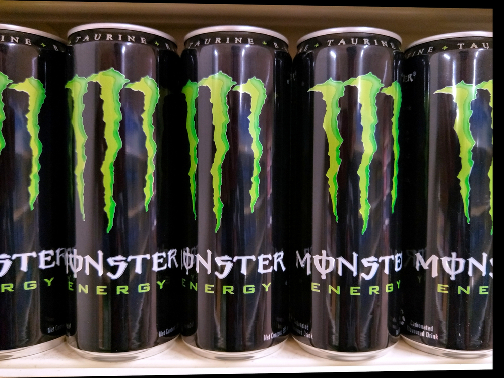 An image of cans of Monster Energy Drink on a shelf